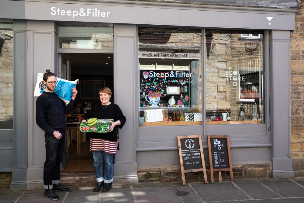 Owners of Steep & Filter eco and grocery store stand in the doorway of their shop in Skipton's Otley Street
