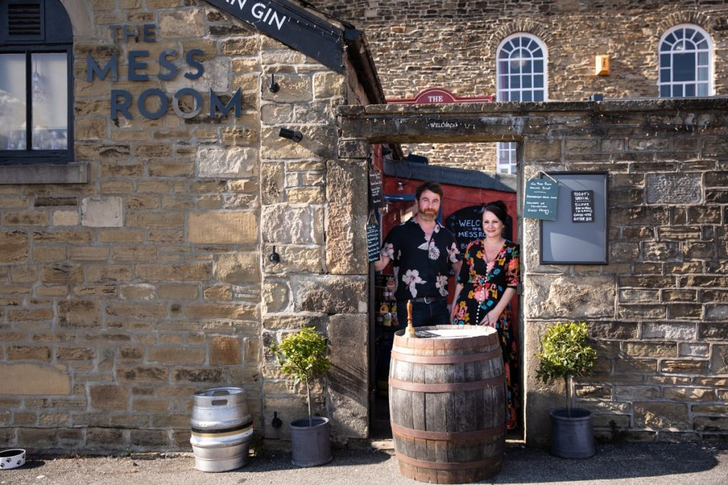 Owners of The Mess Room in Skipton stand in the doorway with a barrel of beer